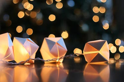 Paper origami cubes folded around string lights